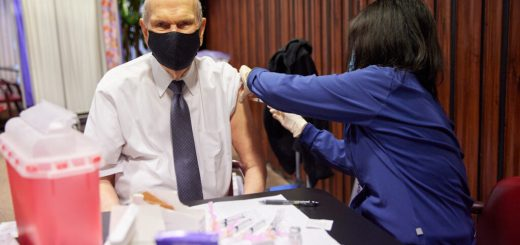 President Nelson receives a vaccine while wearing a mask