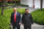 Liberace and Kim Jong Un walking in the park.