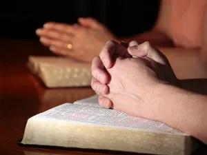 Couple praying © Lincolnrogers | Dreamstime.com