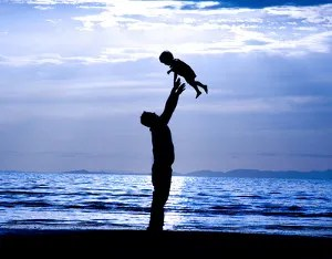 Father playing with child © Mehmet Dilsiz | Dreamstime.com