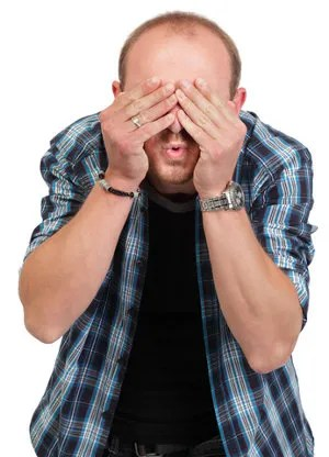 Man hiding from the truth © Hugo Maes | Dreamstime.com