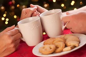 Couple sharing hot chocolate and cookies © Feverpitched   Dreamstime.com