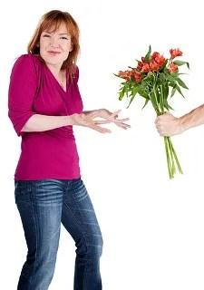 Woman rejecting flowers © Chris Nobel | Dreamstime.com