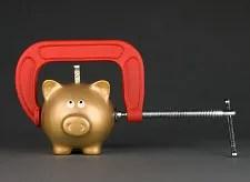 Piggy bank in vice © Kelpfish   Dreamstime.com
