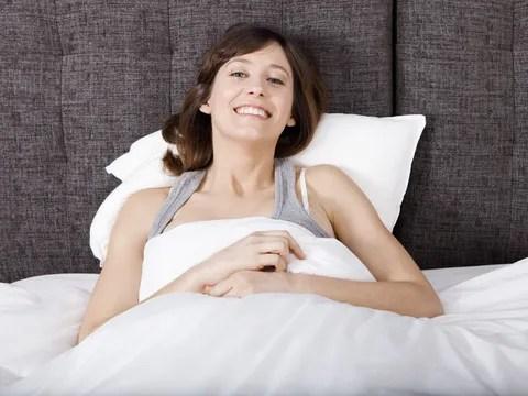 Happy Woman in Bed © Erik Reis | Dreamstime.com
