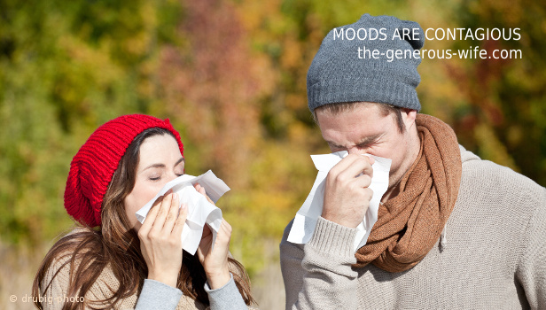 couple sneezing into tissues