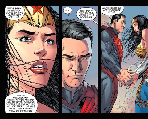 Superman holds Wonder Woman's hand