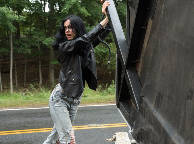 Jessica Jones lifts a car