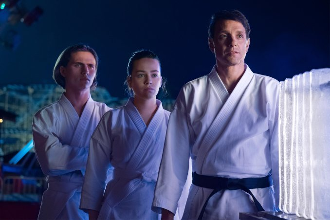 Tanner Buchanan, Mary Mouser and Ralph Macchio in Cobra Kai