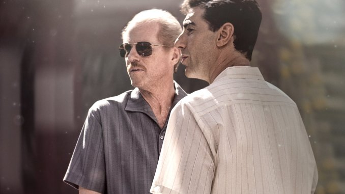 Noah Emmerich and Sacha Baron Cohen in The Spy