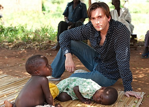 David Tennant with a small African child