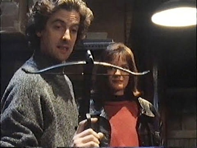 Peter Capaldi with a crossbow in Chandler and Co