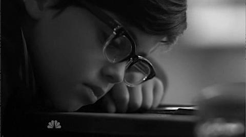A little boy in glasses