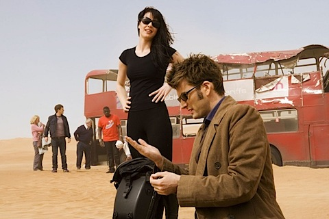 David Tennant playing in the sand