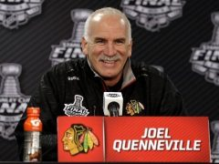 a rare photo of Joel Quenneville smiling