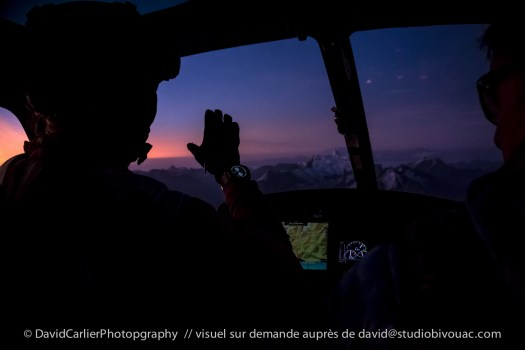 Géraldine Fasnacht on her way to her night flight on her wingsuit over the Alps - photo by David Carlier