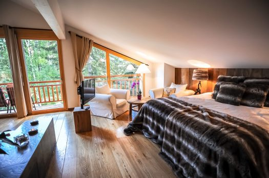 Bedroom with a view at one of Crans Luxury Lodges