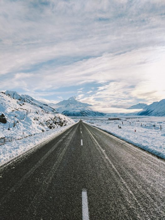 Driving to the mountains. Photo: Samuel Scrimshaw. Unsplash. So, you want to take your family skiing, but you do not know where to start?