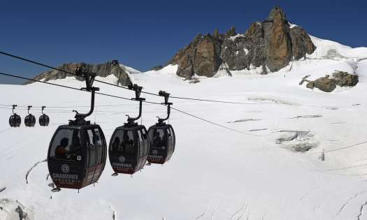 The gondolas that go on top of the Mar de Glace, from Aiguille du Midi in France (Chamonix) to Punta Helbronner in Italy (Courmayeur)