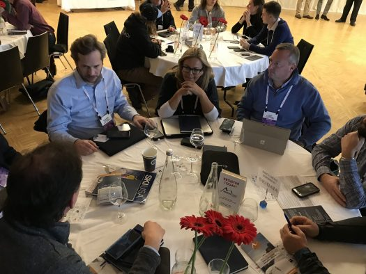 Table talks during the sessions at the European Mountain Travel Summit - Here Eduardo Gaz of Ski USA/Ski Brasil, Cassandra Foister of SkiMax in Australia, and Rick Reichsfeld of Alpine Adventures in the USA. Photo by The-Ski-Guru