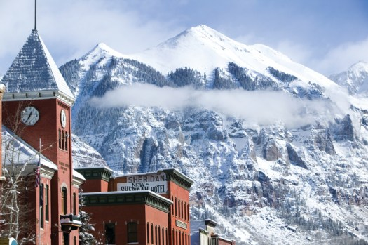 The town of Telluride, a classic picture with the Sheridan hotel and the beautiful San Juan Mountains in the backdrop - picture by Telluride ski resort.
