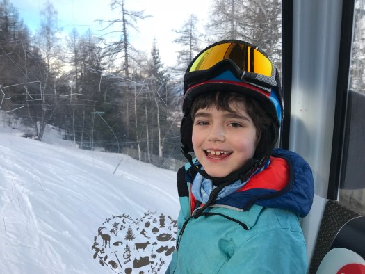 Going up the gondola, one happy child - Photo by The-Ski-Guru - Pila, Aosta Valley.