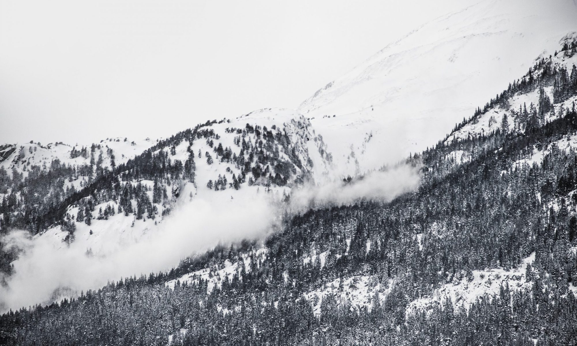 An avalanche has swept two cars while crossing the Klausen Pass in Switzerland. THREE HURT: Cars swept away by Swiss alpine pass avalanche. Photo of an avalanche by Caspar Rubin - Unsplash.