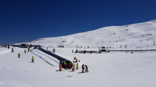 Beginners magic carpet in Sierra Nevada. Sierra Nevada has 70 km of open pistes until the end of this ski season.
