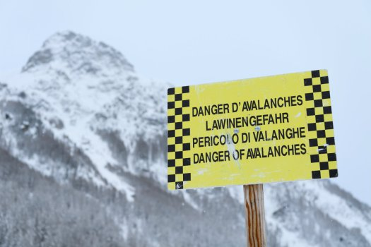 Danger of Avalanches sign in Switzerland. Avalanches claimed two lives in Switzerland due to dangerous conditions.