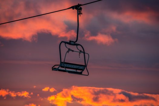 A sunset and a lone chair at Mount Snow. Peak Resorts.