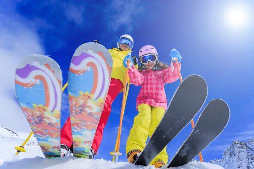 Ski, skiers, sun and winter fun - skiers enjoying ski vacation. Photo CheckYeti/Skiset. CheckYeti enters a strategic partnership with Skiset.