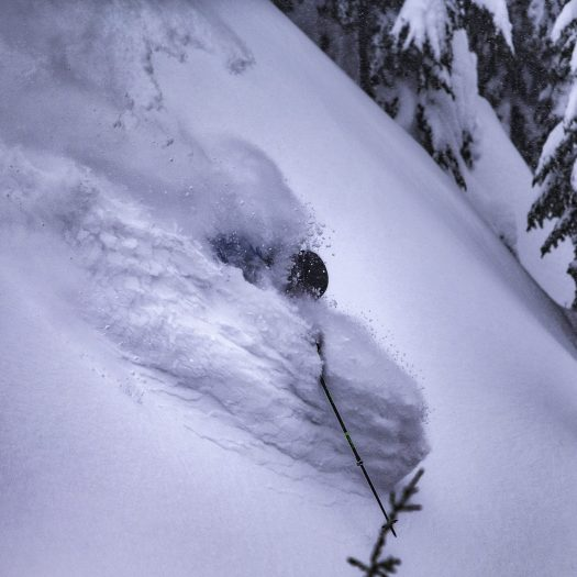 Skier enjoys deep powder after long storm cycle in Whistler Blackcomb. Photo Paul Morrison. Whistler Blackcomb. Vail Resorts. New investments in Whistler Blackcomb to enhance the guest experience will be ready for the 2018-19 ski season.