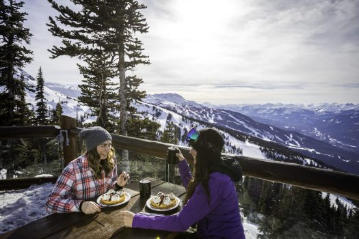 Friends enjoy food and beverages at Crystal Hut in Whistler Blackcomb. Photo: Jeskova - Crystal Hut. Whistler Blackcomb- Vail Resorts. New investments in Whistler Blackcomb to enhance the guest experience will be ready for the 2018-19 ski season.