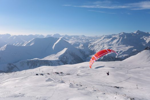 A parapente flying over the slopes of Gudauri Ski Resort. Photo: Mountain Resorts of Georgia. The ski resort Gudauri is rebuilding one lift and adding six new lifts by Doppelmayr and Poma.