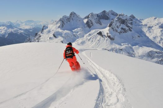 A freeskier enjoying the powder snow at Lech Zürs. Photo by Sepp Mallaun. Lech Zürs Tourism Office. The Must-Read Guide to Lech.