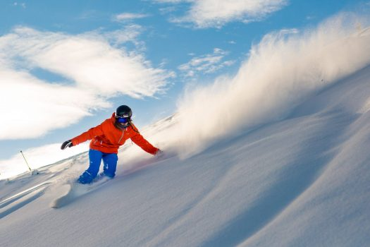 A snowboarder comes down in Snowmass. Snowmass Opens Thanksgiving Day with 570 Acres of Terrain. Photo: Aspen Skiing Company.