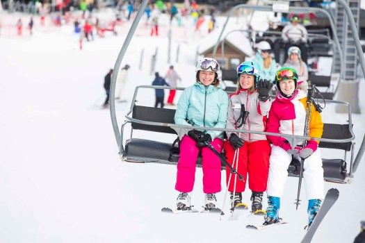 Relaxing those tired legs in a chairlift, a pity that it goes fast now! Snowmass Opens Thanksgiving Day with 570 Acres of Terrain. Photo: Aspen Skiing Company.