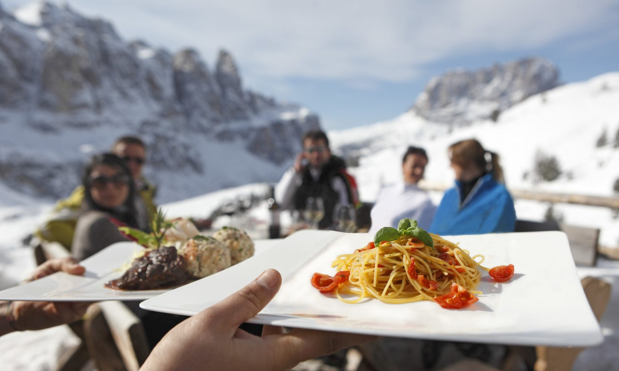 The Alpine huts along the ski slopes of the Gardena Valley serve local fare mixing traditional Italian with South Tyrolean dishes; against the magnificent background of the snow-capped peaks of the Sella Mountain Group in the Dolomites. Photo: IDM Sudtirol - The roof of the Rifugio Comici in Selva Val Gardena was restored in record time. Photo: IDM Sudtirol - The roof of the Rifugio Comici in Selva Val Gardena was restored in record time.