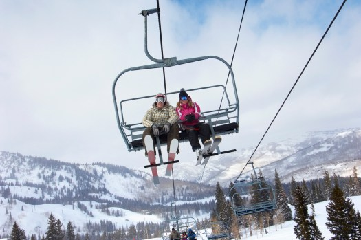 Young Couple on a Chairlift- Photo by ICarhireinsurance.com - Skiers Over New Year Prepare for a £450 Wipeout at the Car Hire Rental Desk.