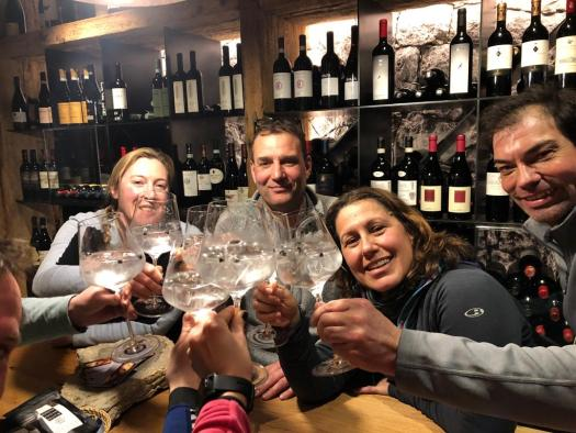 The group tasting the 8025 gin in the cave of Baita Sofie in Seceda. Photo: Claudia Rier. Lunch at Baita Sofie in Seceda, Val Gardena, Dolomiti Superski, Sudtirol.