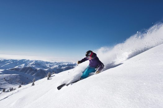 Photo Caption: Bluebird powder day skiing on Bald Mountain. Sun Valley and Snowbasin Join the Epic Pass.