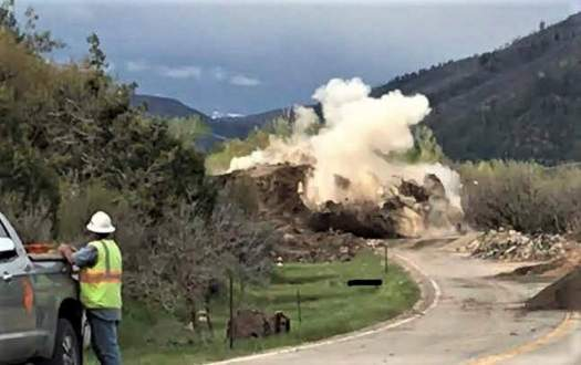 The explosion of the boulder - photo CDOT. A Rockslide, with a boulder of a size of a house, wiped out a section of the highway in SW Colorado