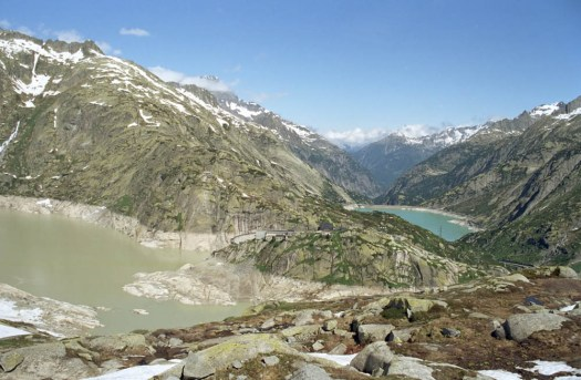 View of the Grimsel Pass and the dam. A drive through the Nufenenpass (Passo della Novena) and Grimsel Pass in Switzerland.
