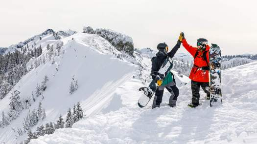 A high five on top - Photo Squaw Valley. Squaw Valley offering $5 passes to ski or ride in June.