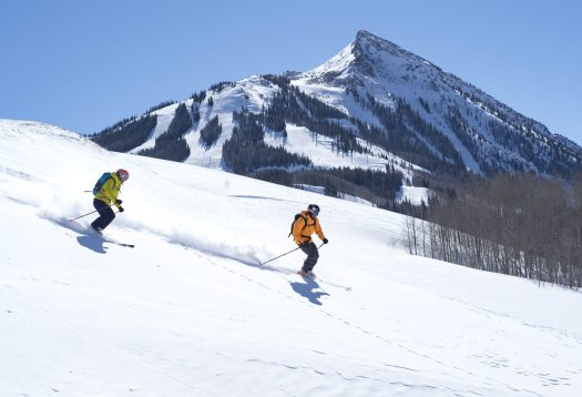 Skiers down the easy slopes on the side of the mountain, with great views of the Butte. Photo: Tom Stillo/CBMR. Final Record of Decision Published for Teocalli Drainage Expansion Project.
