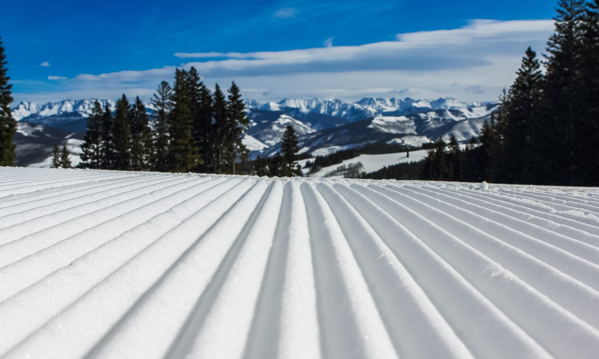 Snow Groomed. Photo by John Price. Unsplash. How ski grooming patterns can affect visibility in the snow.