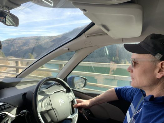 My husband driving over a viaduct near Nantua. Our half term ski-safari holiday based in the Valdigne of Aosta Valley- Courmayeur, Pila and La Thuile.