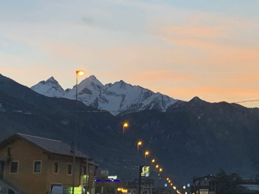 The sun is setting in the mountains coming back from Pila. Our half term ski-safari holiday based in the Valdigne of Aosta Valley- Courmayeur, Pila and La Thuile.