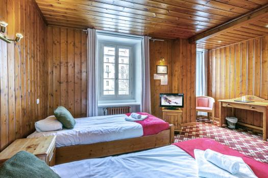 A room with wood panelling at the Hôtel Le Chamonix. Book your stay at the Hôtel Le Chamonix here. Must-Read Guide to Chamonix.
