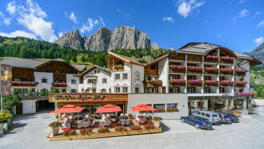 Exterior of the Hotel Kolfuschgerhof in Colfosco. Book your stay at the Kolfuschgerhof here. Planning your summer in the mountains of Alta Badia.